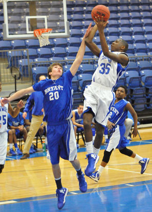 Evan Lee (20) defends against Conway White's Prentice Mullins. (Photo by Kevin Nagle)