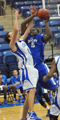 Bryant's Cameron Murray tries to power up a shot over Conway White's Blaine Booher. (Photo by Kevin Nagle)