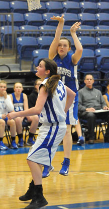 Annie Patton follows through on a jump shot. (Photo by Kevin Nagle)