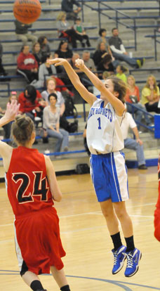 Abby Ostrem takes a shot. (Photo by Kevin Nagle)