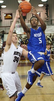 K.J. Hill (5) drives past Benton's Graham Gardner on the way to the basket. (Photo by Rick Nation)