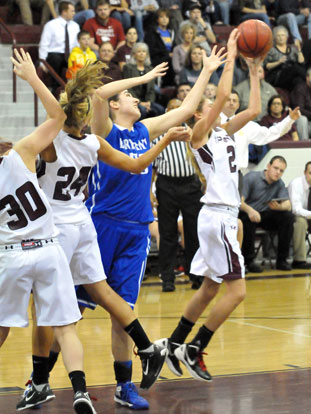 Bryant's Whitney Meyer contends with three Benton players for a rebound. (Photo by Kevin Nagle)