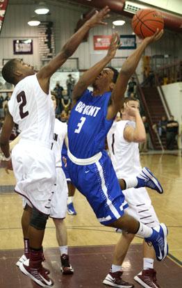 Bryant's C.J. Rainey (3) runs into Benton's Tarek Beaugard on the way to the basket. (Photo by Rick Nation)