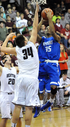 Brian Reed (35) tries to get a shot over Graham Gardner. (Photo by Kevin Nagle)