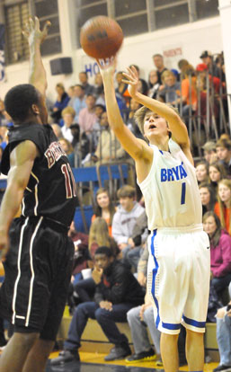Bryant's Tyler Simmons (1) launches a 3 over Benton's Rickey Gipson. (Photo by Kevin Nagle)