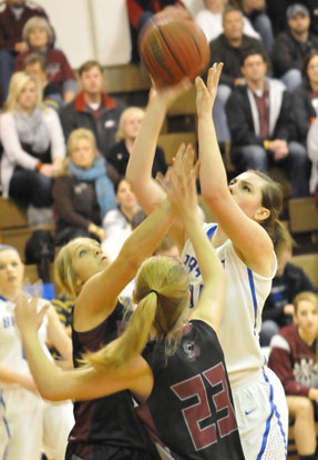 Erica Smith shoots over a pair of Benton defenders. (Photo by Kevin Nagle)