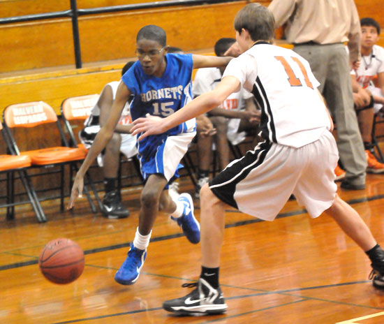 Chris Adams (15) drives past a Malvern defender. (Photo by Kevin Nagle)