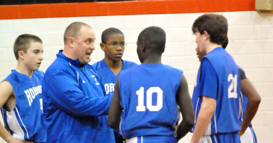 Bryant Blue coach Derek McGrew instructs his crew during a timeout in Monday night's game at Malvern. (PHoto by Kevin Nagle)