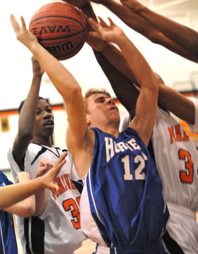 Chase Kincaid (12) goes up for a shot in traffic. (Photo by Kevin Nagle)
