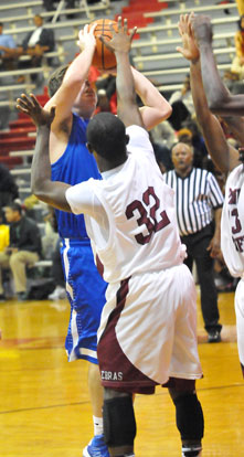 Zach Cambron tries to get a shot over Pine Bluff's Cameron Jackson. (Photo by Kevin Nagle)