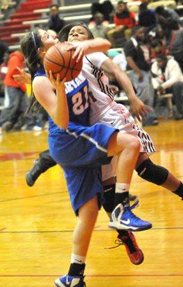 Courtney Davidson gets fouled as she drives to the basket. (Photo by Kevin Nagle)
