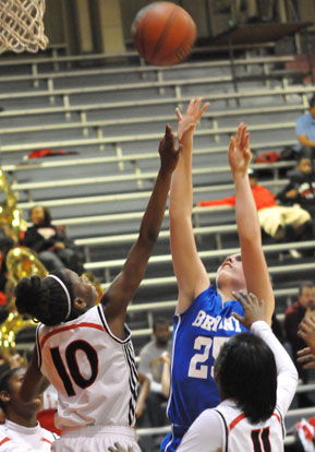 Erica Smith tries to get a shot up in a crowd. (Photo by Kevin Nagle)