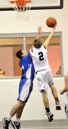 Bryant's Hayden Knowles, left, goes for the block. (Photo by Kevin Nagle)