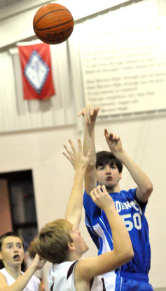 Kyle Sahr fires up a jumper. (Photo by Kevin Nagle)