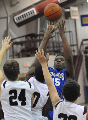 John Winston fires up a shot over a cluster of Benton defenders. (Photo by Kevin Nagle)