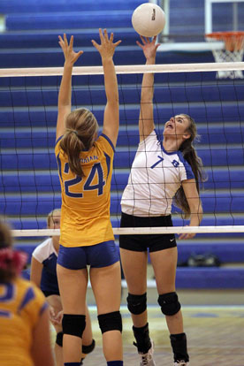 Mercedes Dillard (7) gets a hit over the net. (Photo by Rick Nation)