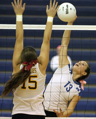 Mariah Aguilar (13) tries to get a hit past a Lake Hamilton defender. (Photo by Rick Nation)