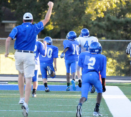 Bryant White head coach Brad Smothermon celebrates the long touchdown run by Grant Botti that put his team ahead late in the fourth quarter. (Photo by Kevin Nagle)