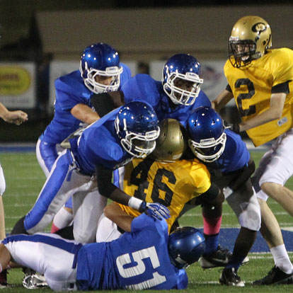 Bryant defenders including Madre Dixon (51) stack up Central's Malik Onwumere. (Photo by Rick Nation)