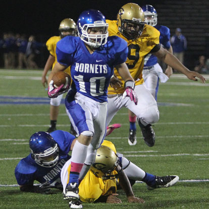 Bryant's Austin Kelly slips a tackle on his way to a touchdown. Kelly caught seven passes for 173 yards and two scores in Thursday's win. (Photo by Rick Nation)