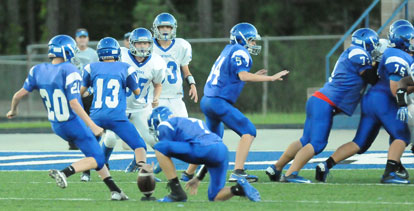 Luke Welch (20) attempts an extra point. (Photo by Kevin Nagle)