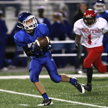 Jake East pulls in a pass on the way to one of his two touchdown receptions. (Photo by Rick Nation)