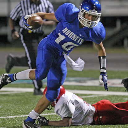 Austin Kelly slips past a Cabot South defender on his way to the end zone. (Photo by Rick Nation)