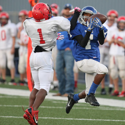 Bryant White's Aaron Griffin (7) grabs a pass despite the efforts of Cabot South's Marc Magwood (1). (Photo by Rick Nation)