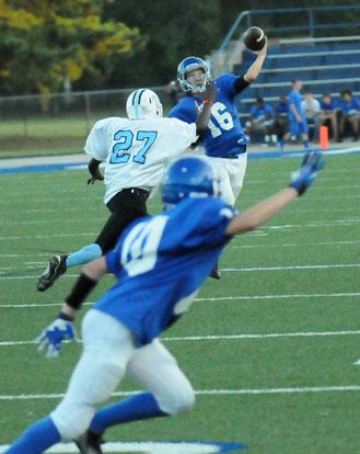 Bryant White quarterback Tristan Calhoun (16) throws past Little Rock Henderson's Byron Bryant (27) towards Neal Brenton (10). (Photo by Kevin Nagle)