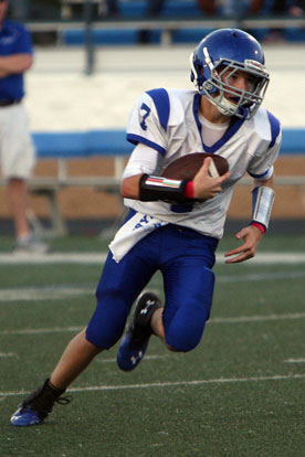 Quarterback Cameron Vail turns upfield. (Photo by Rick Nation)
