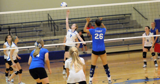 Brooke Snyder goes up for a hit in front of teammate Brianna Ware (8). (Photo by Kevin Nagle)