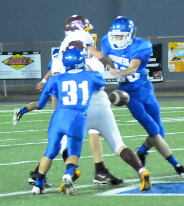 Kaleb Kling (31) forces a fumble that Aaron Eley recovered. (Photo by Kevin Nagle)