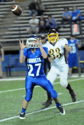 Colin Welch (27) eyes the interception he returned 40 yards for a touchdown. (Photo by Kevin Nagle)