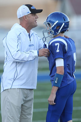 Bethel Hornets head coach Dale Jones gives instructions to his quarterback Cameron Vail during Thursday's game. (Photo by Rick Nation)