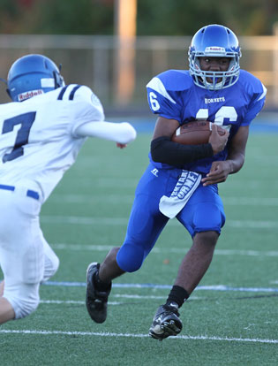 Jonathan Smith (16) maneuvers around a Conway White defender on the way to a 48-yard touchdown run. (Photo by Rick Nation)