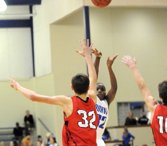 Jonathan Allen fired up a shot over Vilonia's Matt Stanley. (Photo by Kevin Nagle)