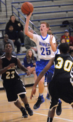 Bethel's Luke Curtis puts up a shot in the lane. (Photo by Kevin Nagle)