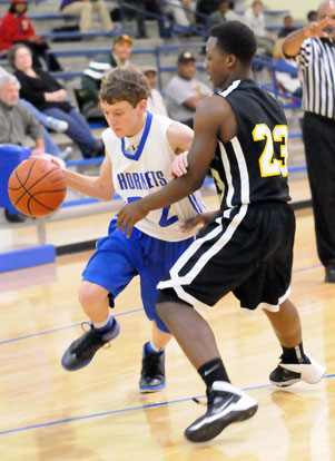 Bryant Blue's Matt Sandidge work his way to the basket. (Photo by Kevin Nagle)