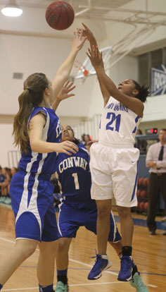 Destiny Martin shoots over a Conway White defender. (Photo by Rick Nation)