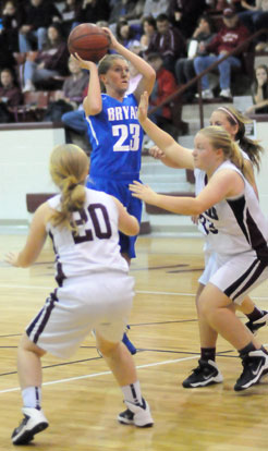 Kendal Rogers launches a shot over a pair of Benton defenders. (Photo by Kevin Nagle)