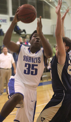 John Winston (35) goes up for a shot. (Photo by Rick Nation)