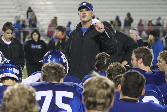 Bryant head coach Paul Calley addresses his team after Friday night's game. (Photo by Rick Nation)