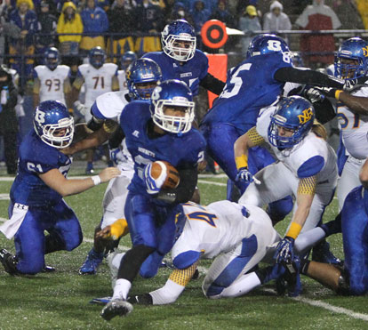 Brushawn Hunter tries to turn the corner off of blocks by Kurt Calley (61) and Jacob Ward (65). (Photo by Rick Nation)