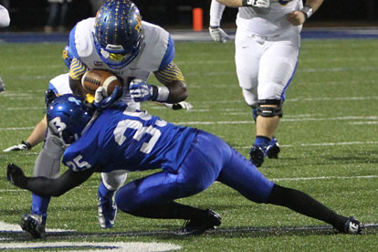Jake Johnson (35) makes a tackle for the Hornets. (Photo by Rick Nation)
