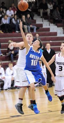 Garrett Cowart (10) scoops up a shot under the basket. (Photo by Kevin Nagle)
