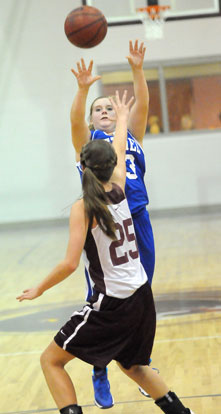 Stephanie Cullen fires a shot over a Benton defender. (Photo by Kevin Nagle)