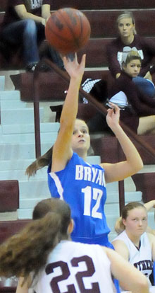 Sarah Kennedy shoots over Benton's Lenzie Newman. (Photo by Kevin Nagle)