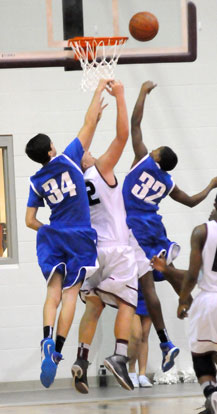 Bryant's Kyle Sahr (34) and Jonathan Allen (32) contest a shot under the basket. (Photo by Kevin Nagle)