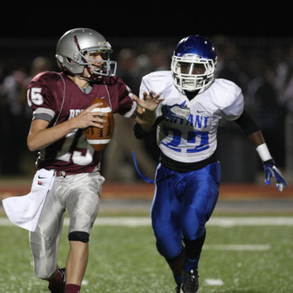 Bryant's Phillip Isom-Green bears down on Benton quarterback Nate Beck. (Photo by Rick Nation)