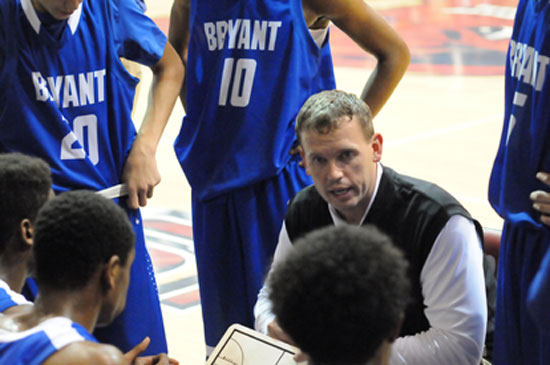 Bryant head coach Mike Abrahamson talks to his players during a timeout. (Photo by Kevin Nagle)